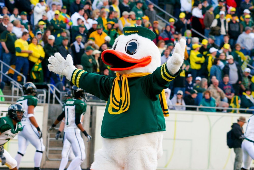 U of O Duck posing for a photo during a football game